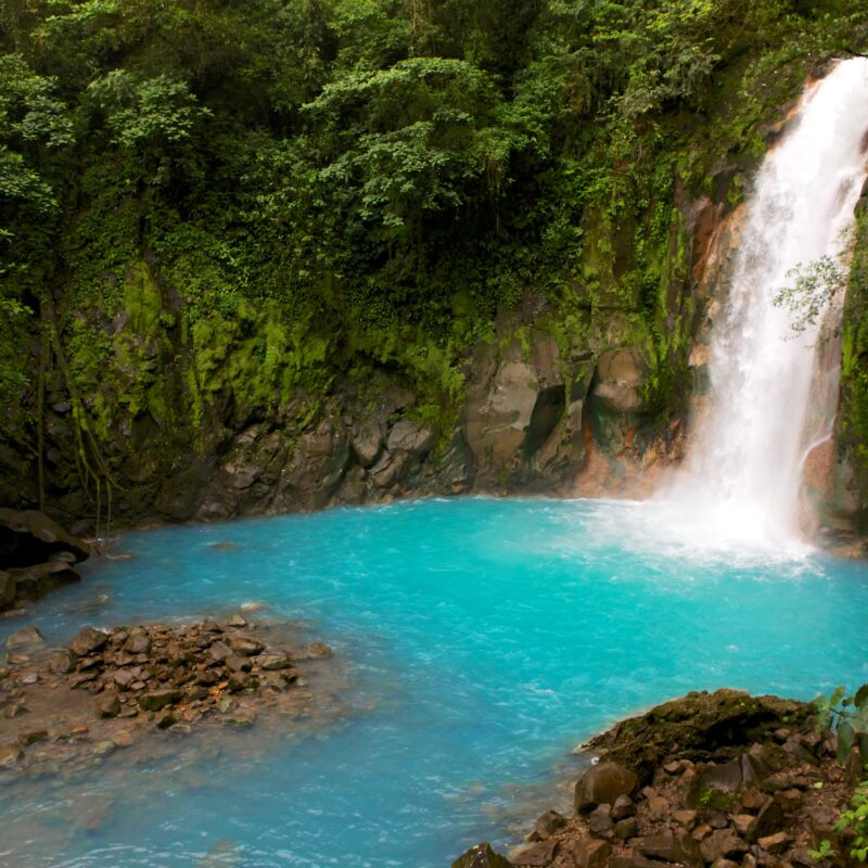 Celestial blue waterfall in volcan tenorio national park costa rica central america